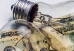 A lightbulb on dollar bill energy saving concept