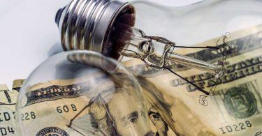 A lightbulb on dollar bill energy saving concept