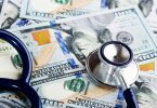 A medical stethoscope on dollars