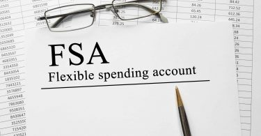 Paper with Flexible Spending Account FSA on a table