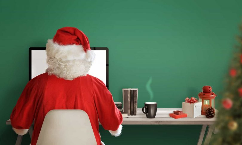 santa shops online using debt.com money tips