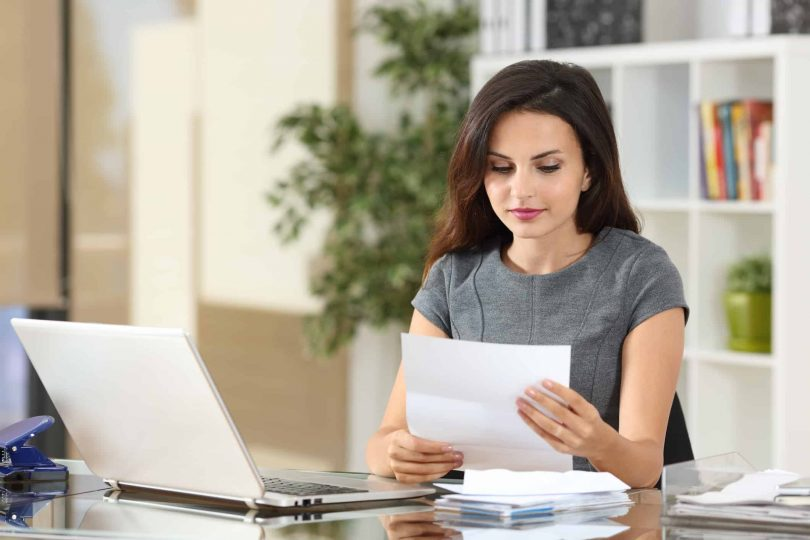 Female small business owner plans to open her own business checking account