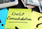 Debt consolidation written by hand and money