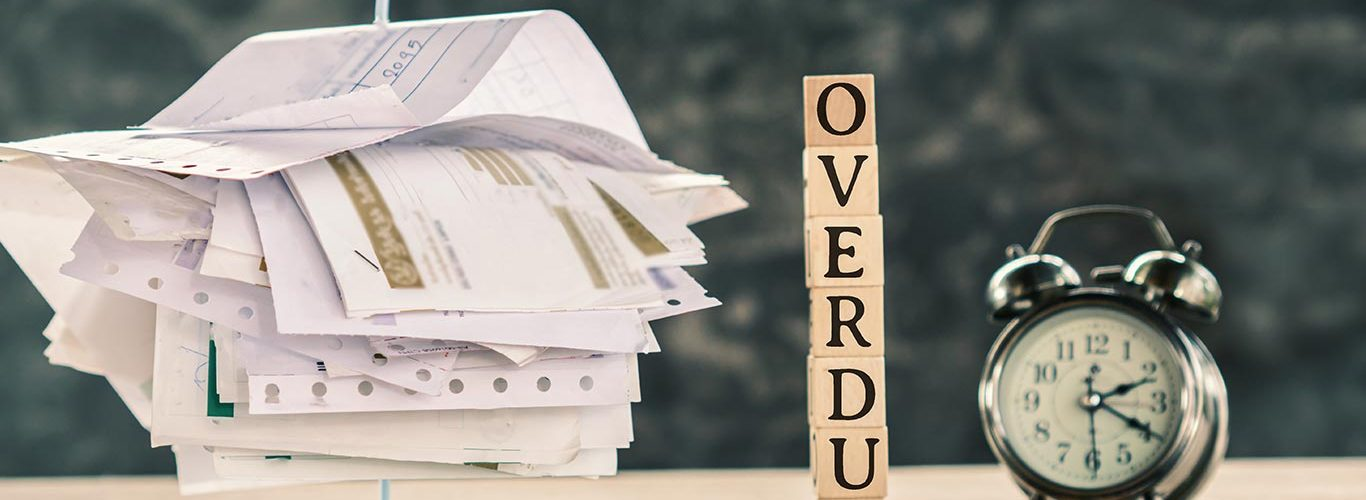 Overdue concept with stack of unpaid bills